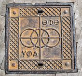 picture of manhole  - UFA City manhole cover in Bashkir and Russian language in wrought Iron - JPG