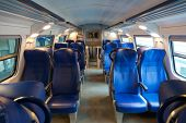stock photo of railroad car  - Interior of the European car of the intercity train with sedentary places - JPG