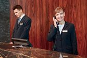 image of receptionist  - Reception on the phone - JPG