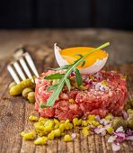 picture of tartar  - Close up of beef tartar with capers gherkins - JPG