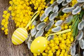 pic of mimosa  - French fresh  mimosa and catkins with easter eggs on wooden table - JPG