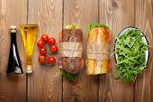 picture of tomato sandwich  - Two sandwiches with salad - JPG