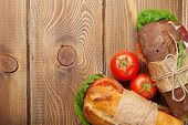 stock photo of tomato sandwich  - Two sandwiches with salad - JPG