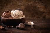 stock photo of ijs  - Chocolate and stracciatella ice creams in wooden bowlselective focus - JPG