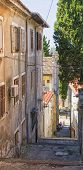 stock photo of descending  - Narrow descending stairs street in Pula - JPG