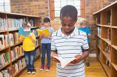 pic of pupils  - Pupils looking for books in library at elementary school - JPG