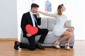 picture of hand kiss  - Businessman kissing his girlfriend hand on the living room - JPG