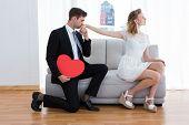 foto of hand kiss  - Businessman kissing his girlfriend hand on the living room - JPG