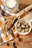 foto of chicken-wire  - Eggs and whisk on wooden table - JPG