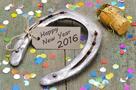 stock photo of year horse  - Happy new year 2016 with horse shoe as lucky charm and cork of champagne - JPG
