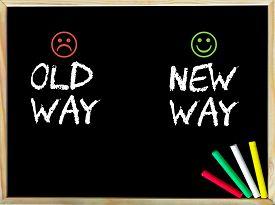 stock photo of emoticon  - Old Way versus New Way message with sad and happy emoticon faces - JPG