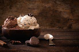 stock photo of ijs  - Chocolate and stracciatella ice creams in wooden bowlselective focus - JPG