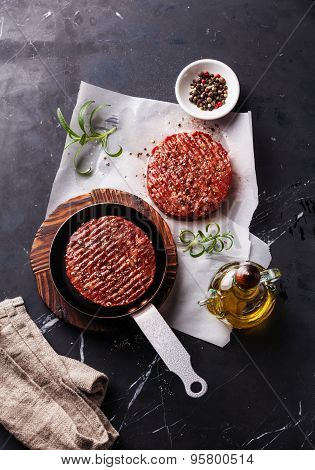Raw Ground Beef Meat Burger Steak Cutlets And Seasonings On Dark Marble Background