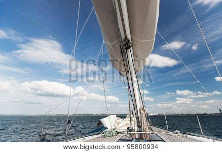 vacation, travel, cruise and leisure concept - close up of sailboat mast or yacht sailing on sea