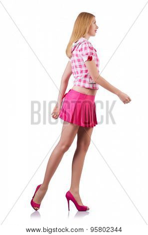 Walking young girl in pink isolated on white