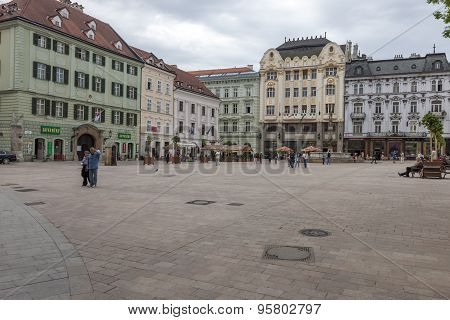 BRATISLAVA, SLOVAKIA - MAY 07 2013: Tourists and residents on Main City Square in Old Town