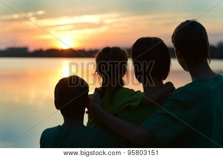 Silhouette, happy children with mother and father