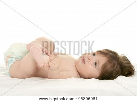 Baby girl lying in pampers