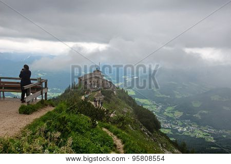 OBERSALZBERG, GERMANY - JUNE 22: Unidentifiable Person on Lookout with View of Eagles Nest, a Third Reich Tourist Attraction Presented to Hitler, Overlooking Obersalzberg, Germany on June 22, 2015