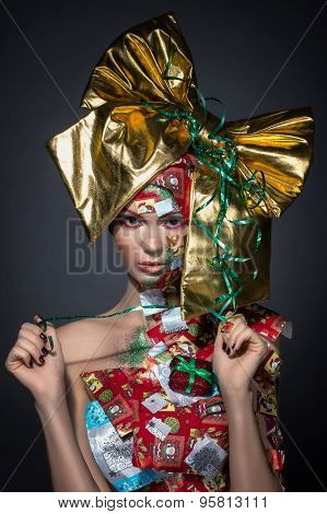 Woman christmas present with red bow on head