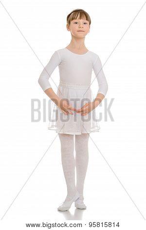 Slender beautiful girl in sports a white leotard