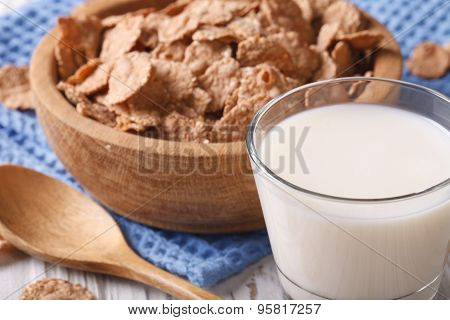 Healthy Bran Flakes In A Wooden Bowl And Milk Close-up. Horizontal