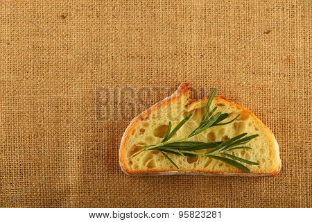Canvas With Rosemary Leaves On Slice Of Wheat Bread