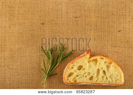 Canvas With Rosemary Leaves And Slice Of Wheat Bread
