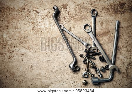 Wrench with nuts and bolt. Space for text.