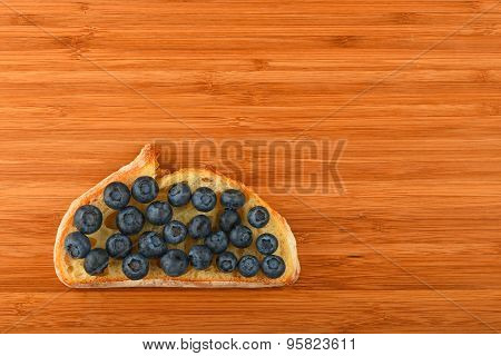 Cutting Board With Sandwich Of Blueberries On Slice Of Bread