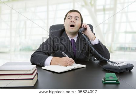 businessman writing on a desk at the office