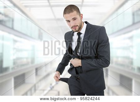 businessman showing his empty pocket, at the office