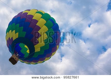 hot air balloon being carried off by the wind