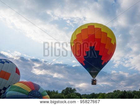 Hot Air Balloon taking off with cloudy skies