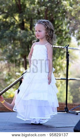 Little Angel In White Dress At Beauty Pageant