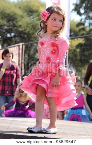 Little Angel In Orange Dress At Beauty Pageant