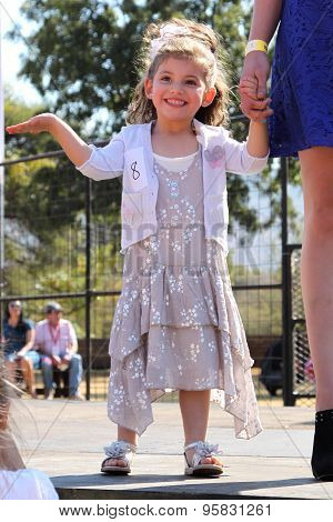 LittleAngel in dress at Beauty Pageant at Festival