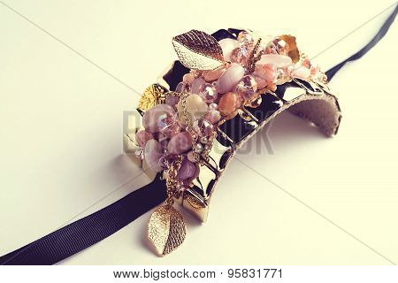 Golden fashion handmade bracelet on white background