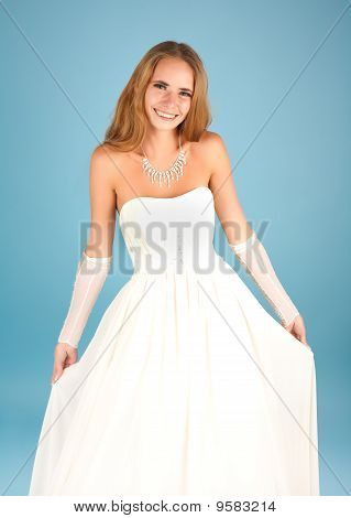 Beautiful Bride Smiling On The Blue Background