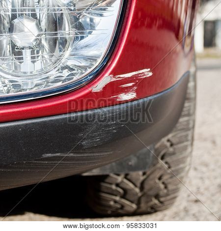 Scratch On A Car's Bumper - Right Under The Headlight