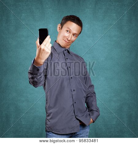 Asian man making a selfie on cell phone to social network