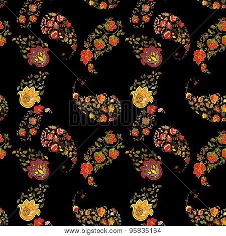 Oriental boho paisley seamless pattern with black background.  Floral motifs.