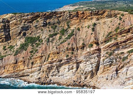 Rocky Beach And Sandstone Cliffs