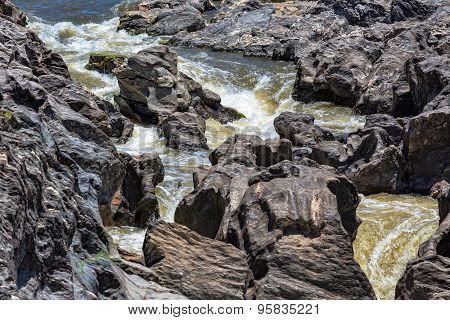 Waterfall Flowing Between The Lava Stones
