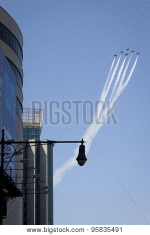 NEW YORK - MAY 22 2015: US Air Force Thunderbird F-16 jets fly above Manhattans west side in a diamond formation with precision during Fleet Week NY 2015 as part of the Memorial Day celebrations.