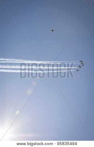 NEW YORK - MAY 22 2015: US Air Force Thunderbird F-16 jets perform the Missing Man Formation salute with precision during Fleet Week 2015 as part of Memorial Day celebrations in NY, natural sun flare.