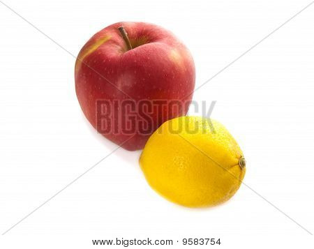 Red Big Apple And Yellow Lemon