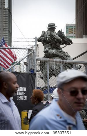 NEW YORK-FEB 2013: People pass by the bronze Americas Response Monument, the first monument dedicated to US Special Forces, during construction in 2013 of the Freedom Tower at One World Trade Center.