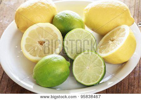 Lemons And Limes On A Dish