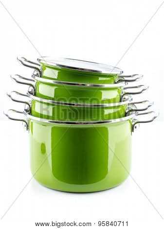 Set of four green enamel pots shot on white background